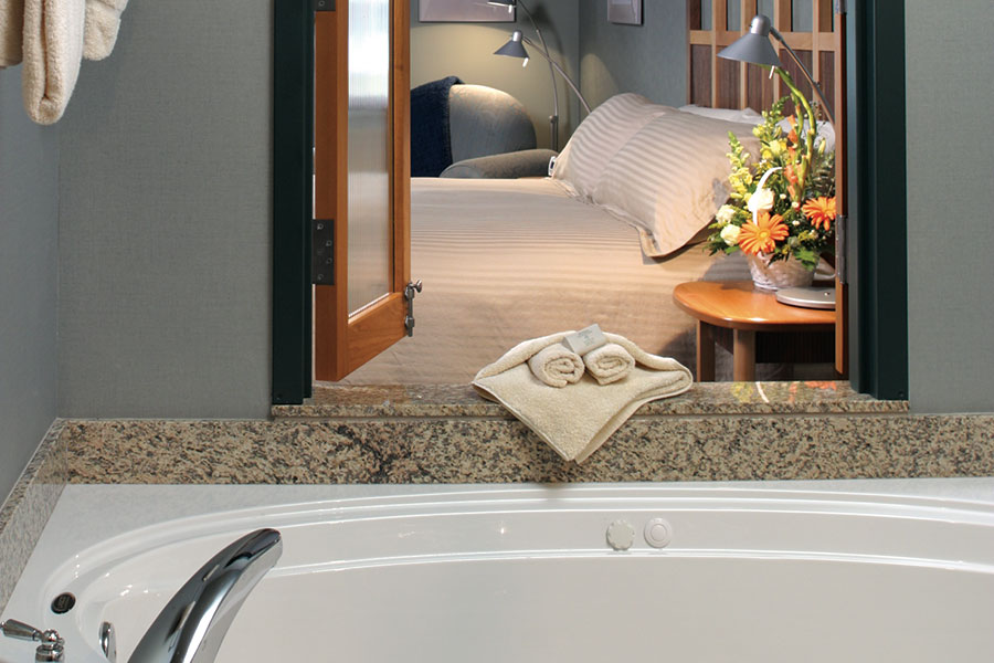 guest room with king bed and jetted tub